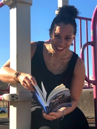 Esther Smiling with book